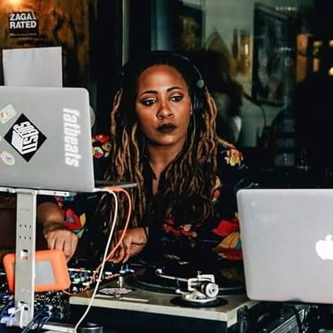 DJ Aura behind her turntables
